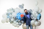 People, Joy, Birthday, Celebration. Handsome Man Celebrating Something. Bearded Man In Suit Holds Bi poster