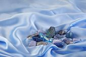 Blue Throat Chakra Healing Crystals On Light Blue Silk - Assorted Blue Coloured Crystal Quartz Miner poster