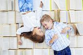 Children, Schoolchildren, Are Lying On A Lot Of Book. Boy And Girl. The Concept Is Back To School, E poster