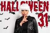 Attractive Woman In White Wig Showing Shh Gesture Near Bloody Halloween 31 Lettering poster