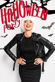 Attractive Woman In White Wig Smiling And Looking At Camera Near Red Halloween Party Lettering poster
