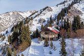 Winter Snowy Mountains with sun in Ak Bulak, Almaty, Kazakhstan, Asia poster