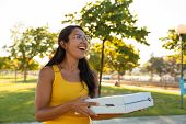 Happy Excited Young Woman Carrying Pizza For Outdoor Party In Park. Beautiful Woman Standing Outdoor poster
