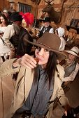 Woman In Cowboy Hat Drinks Whiskey