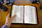stock photo of preacher  - the preacher read the Bible in church - JPG