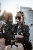 Vertical Portrait Of A Happy Young Black Female With Braids And In A Denim Jacket And Sunglasses Lea poster