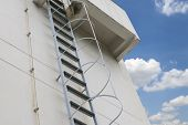 Steel Stairs Are Installed On The Side Of The Building And Supported By A Back Support. Steel Ladder poster