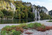 Danube Valley At Danube River Breakthrough Near Kelheim, Bavaria, Germany In Autumn With Gravel Bank poster