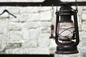 Kerosene Lamp On The Background Of A Stone Wall