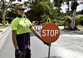 Road worker controls traffic flow