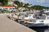 BRELA, CROATIA - APRIL 14: Small boats moored in the harbour on April 14, 2008 at Brela, Croatia. Originally a farming community, Brela has become a popular tourist resort on the Makarska Riviera.