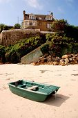 Boat and a house on a beach in Bretagne in France