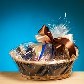 picture of gift basket  - gift in a basket against blue background - JPG