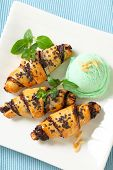 three croissants with pistachio ice cream on the square plate
