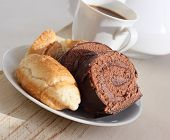 Chocolate biscuit and coffee with milk.