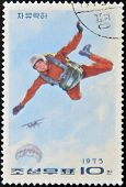 A stamp printed in North Korea shows parachutist