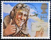 A stamp printed in Great Britain shows the comic hero Biggles