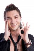 Smiling Boy Listening To Music With White Headphones