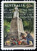 A stamp printed in Australia shows Lest We Forget - Age shall not Weary them nor the Years Condemn