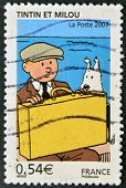 A stamp printed in France shows Tintin and Snowy