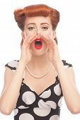 Portrait of a attractiva pinup woman screaming out loud, isolated on a white background