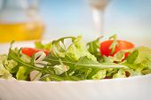 stock photo of rocket salad  - Healthy vegetable salad with lettuce spring onion rocket salad tomatoes and radish - JPG