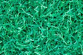 Close-up Of Green Shredded Paper Packaging Material Background