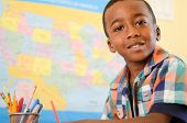 stock photo of schoolboys  - Portrait of an African American little boy in school - JPG