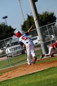 stock photo of little-league  - Little league baseball pitcher throwing to first base - JPG