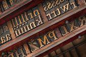 vintage typesetter drawers with letterpress wood type printing blocks