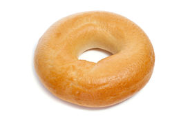 stock photo of doughy  - a plain bagel on a white background - JPG