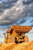 pic of dumper  - Empty heavy mining truck at dramatic sunset - JPG