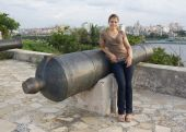 Girl Standing Beside A Cannon With Havana In The Backgroud