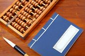chinese book , abacus and writing brush