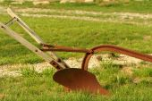 stock photo of horse plowing  - old rusty single - JPG