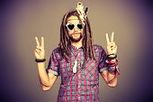 stock photo of dreadlocks  - Portrait of a hippie young man in spectacles - JPG