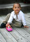 Постер, плакат: Мальчик играет