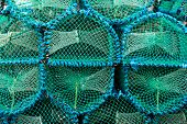 Closeup of blue and green lobster pots