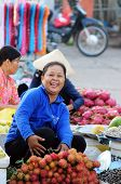 woman selling fresh fruits at the local market