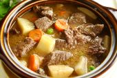 foto of stew  - Rich hearty beef stew simmering and ready to serve - JPG