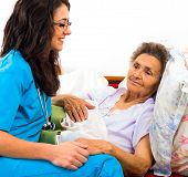 Kind Nurse With Elderly