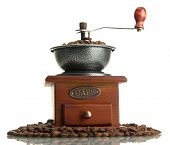 Coffee grinder with coffee beans, isolated on white