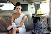 Beautiful smart woman sitting in limousine.
