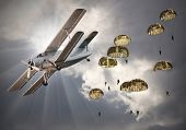 stock photo of parachute  - Retro style picture of the biplane with skydivers - JPG