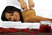 stock photo of deep-tissue  - young African American client getting a massage - JPG