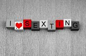 stock photo of kinky  - I Love Sexting as a sign for explicit text messages and sexy photos by mobile phone - JPG