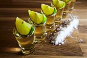 stock photo of lime  - tequila lime and salt on wooden table - JPG
