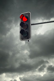 stock photo of street-walker  - Stop light the red traffic light on a cloudy day - JPG