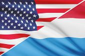 Series Of Ruffled Flags. Usa And Grand Duchy Of Luxembourg.