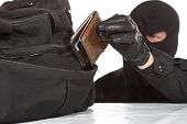 stock photo of raider  - Thief stealing a wallet and a bag on a white background